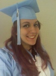 Image of white woman with purple hair wearing Carolina blue graduation regalia